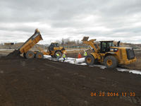 April 2014 - Contractor places soil over white geotextile fabric on Jersey City property