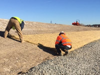 December 2016 - Placing erosion control matting on the south slope of the SA6 North open space area