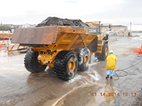 Janurary 2014 - A worker washes truck tires