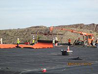 September 2015 - Placing orange geotextile in open space